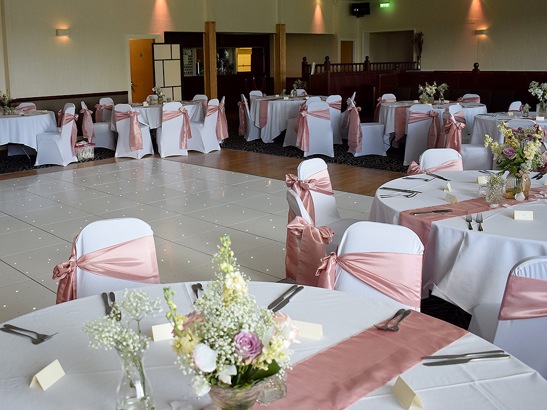 Wedding breakfast venue peach colours led dance floor